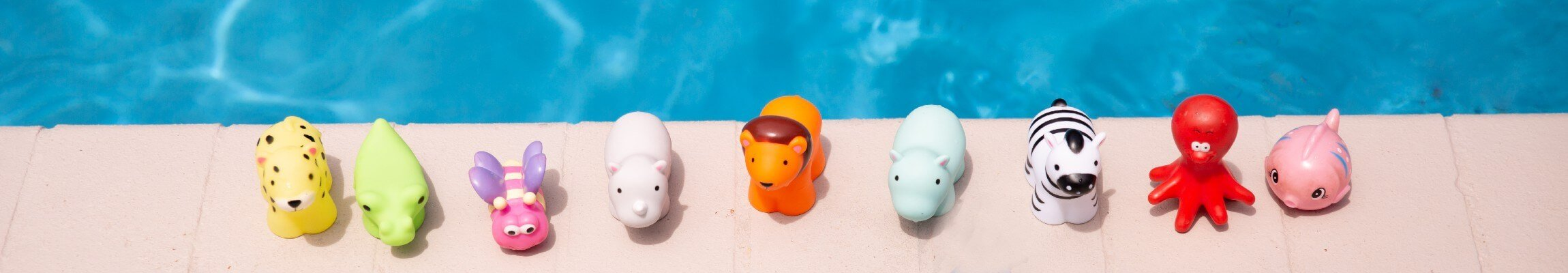 Baby toys waiting by the pool