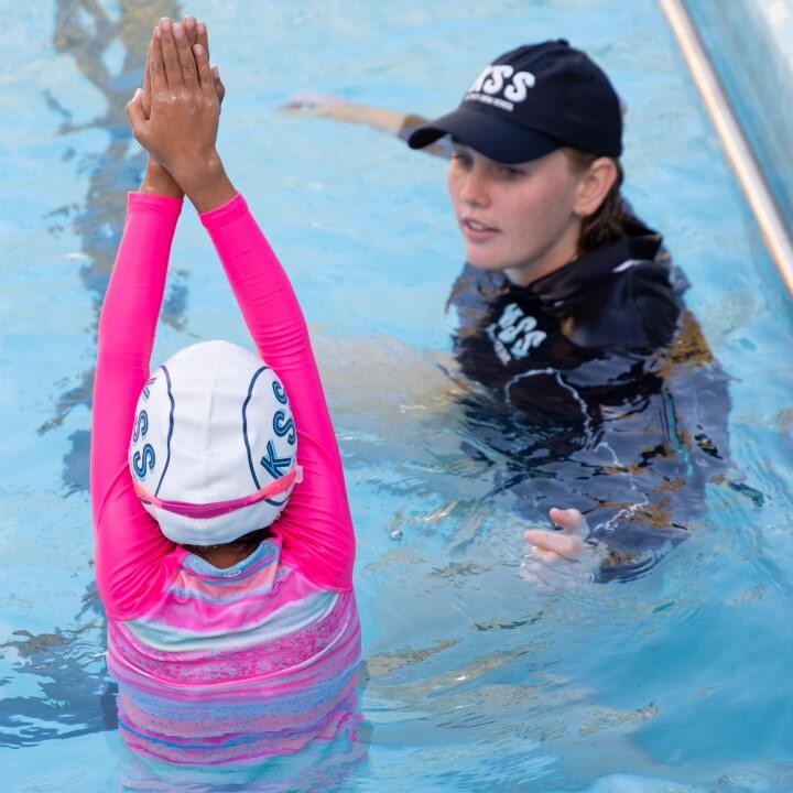 Swim instructor with one student