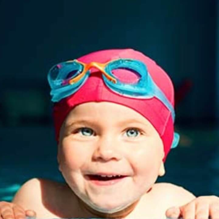 Baby smiles from the waters edge