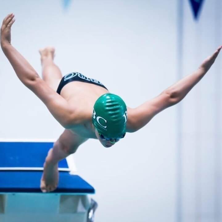 Swimmer dives off the blocks