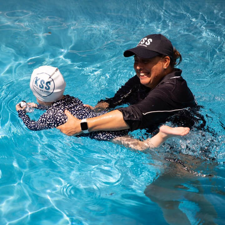 Kattya with Toddler learning to swim